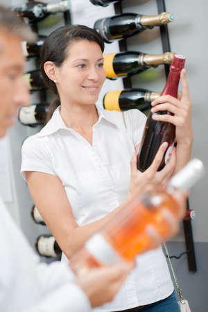 buying: Couple buying wine together