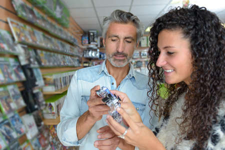 Man and woman comparing two items in a store