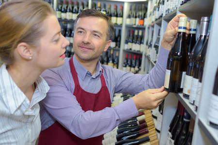 retailer: Wine retailer advising client Stock Photo