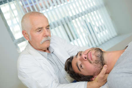 manipulating: Doctor manipulating patients neck