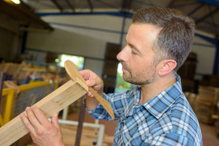 sawmill employee working with wood tools and machinery Stock Photo