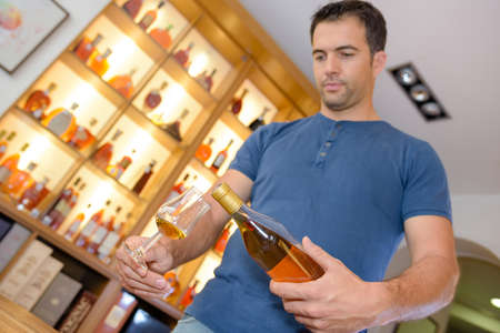man pouring some alcohol Stock Photo