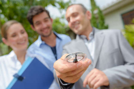 first time buyer: visiting property with agent Stock Photo