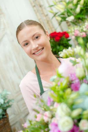 serf: vendor in flower shop Stock Photo
