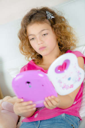 illiteracy: Young girl with electronic book Stock Photo