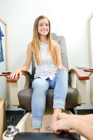 woman foot: Young woman receiving a foot massage Stock Photo