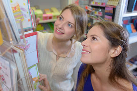 retailer: Women looking at greeting cards