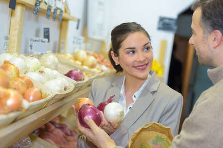 Customer looking at selection of onions Stock Photo