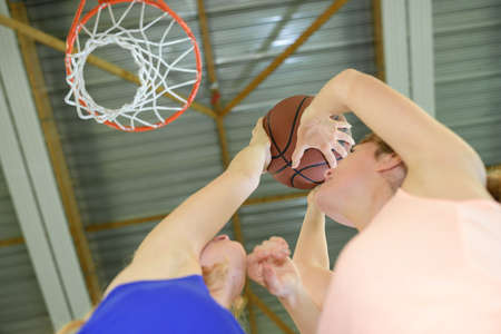 competitive sport: Women aiming for basketball net Stock Photo