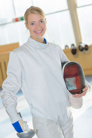 Portrait of woman wearing fencing equipment
