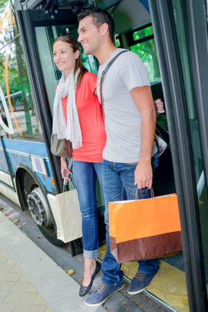 accomplices: Couple getting off a bus