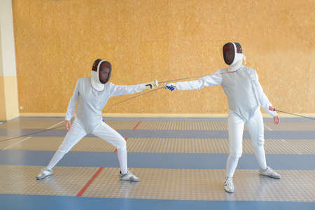 swordsmanship: Two people in fencing combat Stock Photo
