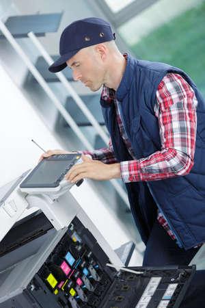 technical department: printer technician fixing a printer