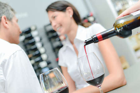 serf: Pouring red wine