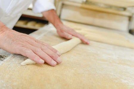 flatten: Rolling bread dough Stock Photo