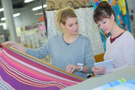 Women looking at textiles Stock Photo