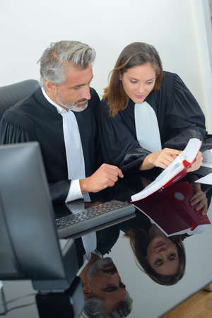solicitors: lawyers at a meeting