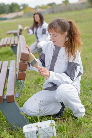 colouration: Women staining park benches