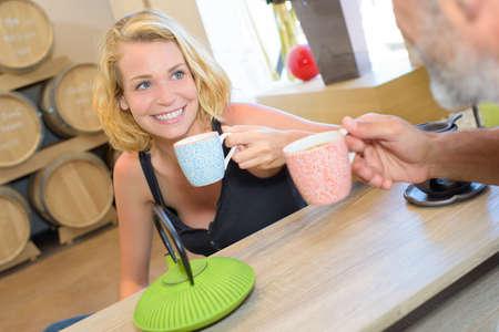 Lady enjoying a coffee with male friend Stock Photo
