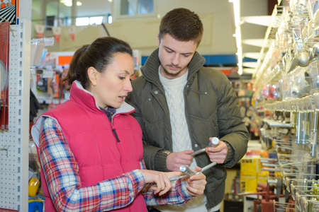 mid thirties: beautiful hardwarestore saleswoman helping customer