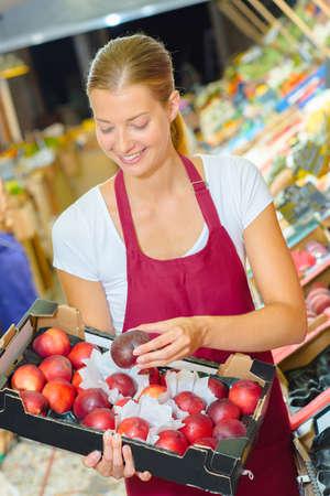 salesgirl: salesgirl in supermarket