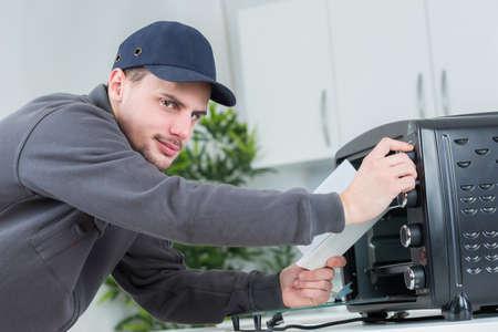 appliance: Man setting up appliance