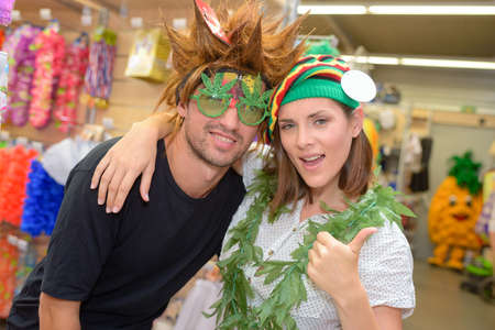 herbe: portrait of happy couple having fun trying costumes Stock Photo