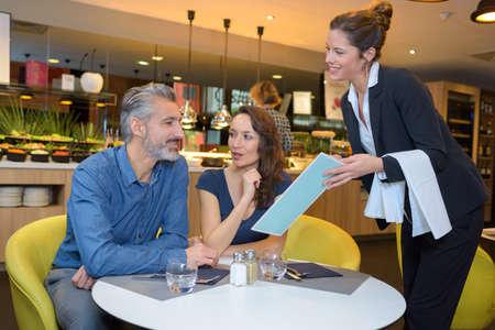 restaurant rating: waitress giving the menu