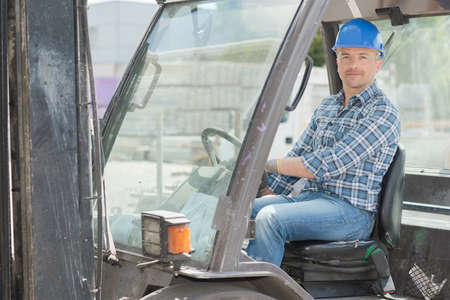 worker using forklifts to move products Stock Photo