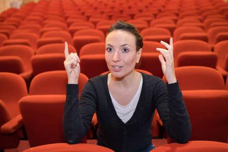 Lady sat in empty theatre