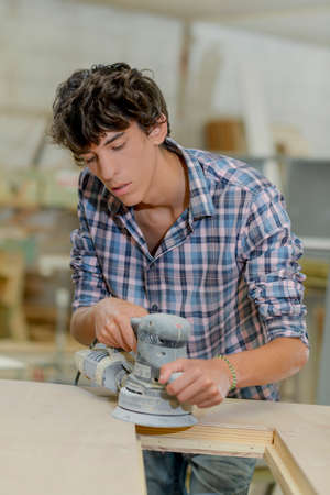 cabinetry: apprentice at work Stock Photo