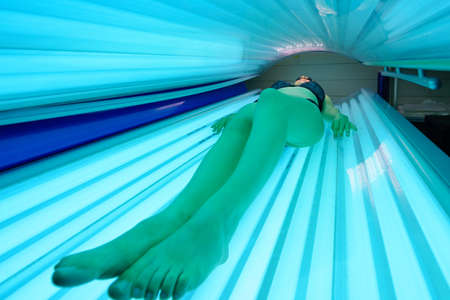 Woman layed on sun bed Stock Photo