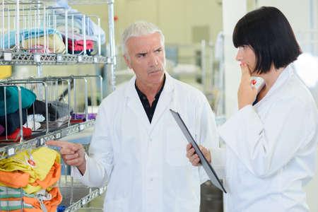 reprimanding: Man reprimanding female colleague for mistake