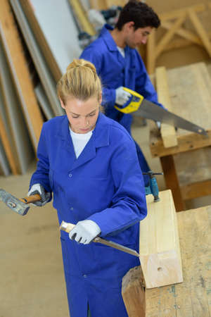 handtool: Male and female carpenters at work Stock Photo