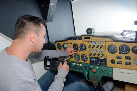 simulator: Man in aircraft simulator