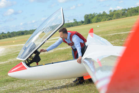 Man in airfield with glider Stock Photo