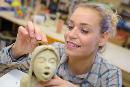 sculpting: Female sculptor at work Stock Photo