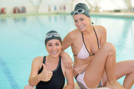 to drown: two women in the pool area