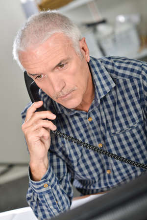 Architect on the phone to a client Stock Photo