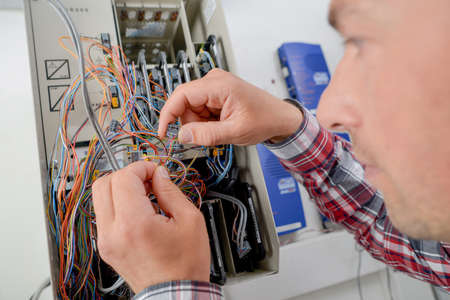 fusebox: Replacing fusebox wire Stock Photo