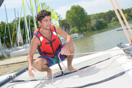 young man going sailing
