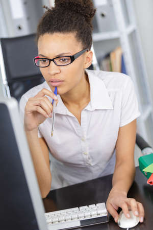 waistup: portrait of businesswoman thinking inside the office Stock Photo