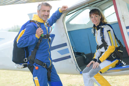 parachutists: Portrait of male and female parachutists Stock Photo