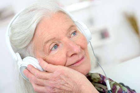 withdrawn: elderly woman with headphones