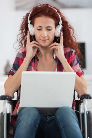 self contained: disabled happy woman enjoying music