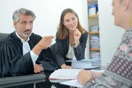 Judge pointing at client Stock Photo