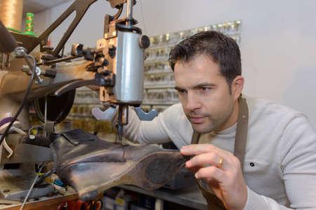 machinery machine: cobbler repairing a shoe