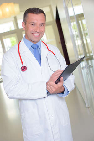 Smiling doctor with clipboard