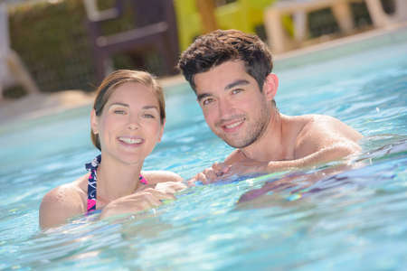 immersed: Man and woman in pool