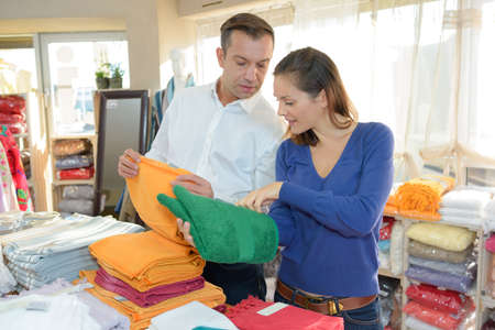toweling: Couple looking at towells in a shop